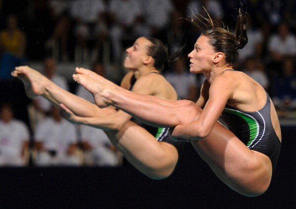 Italian Tania Cagnotto and Francesca Dallape (back) compete during the women's 3m springborad synchro diving final of the 31st LEN European Swimming Championships, on May 20, 2012 in Eindhoven. AFP PHOTO/JOHN THYS        (Photo credit should read JOHN THYS/AFP/GettyImages)