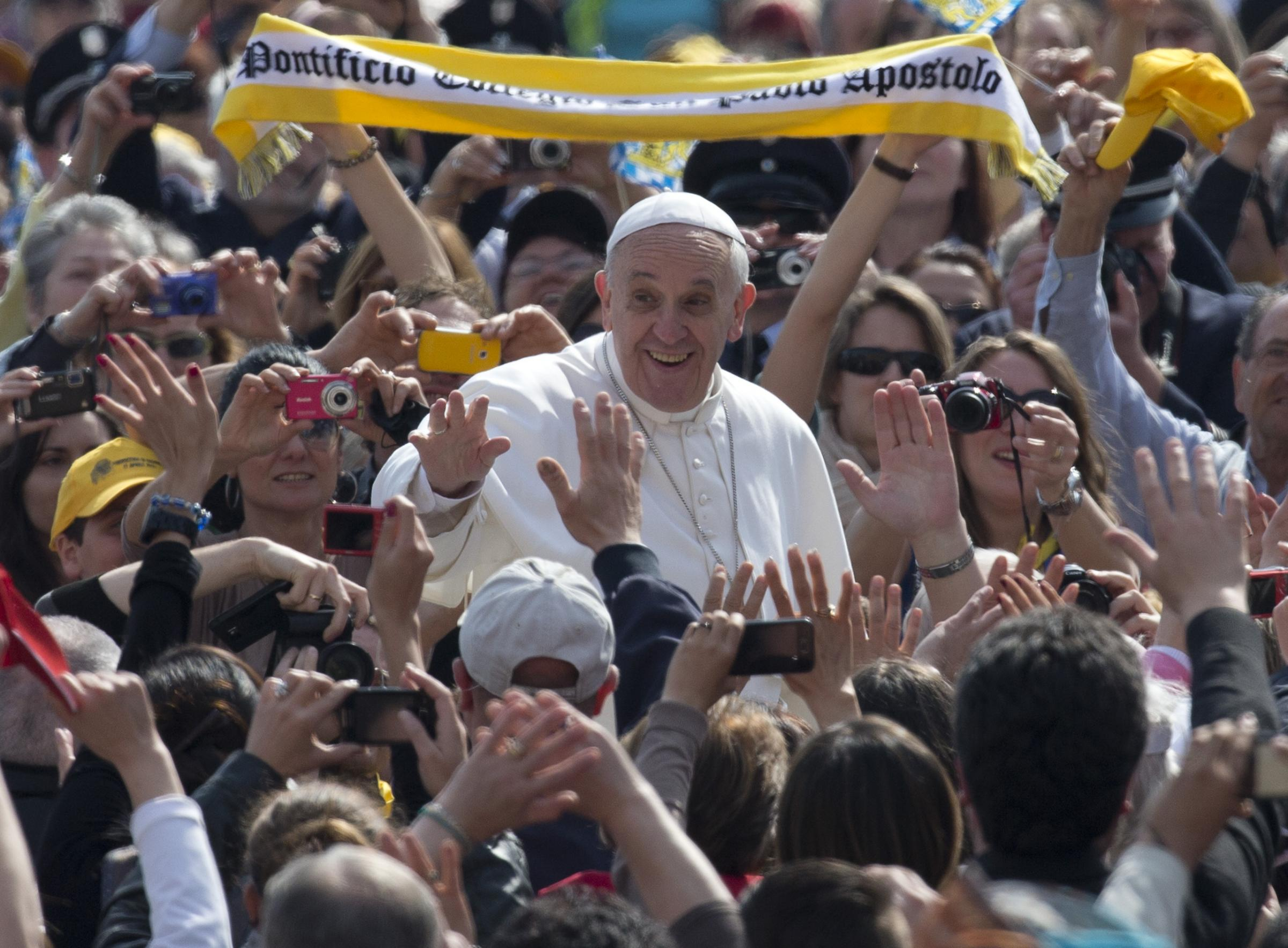 Pope Francis arrives for his weekly general audience in St. Peter square at the Vatican, Wednesday, April 17, 2013. (AP Photo/Alessandra Tarantino)